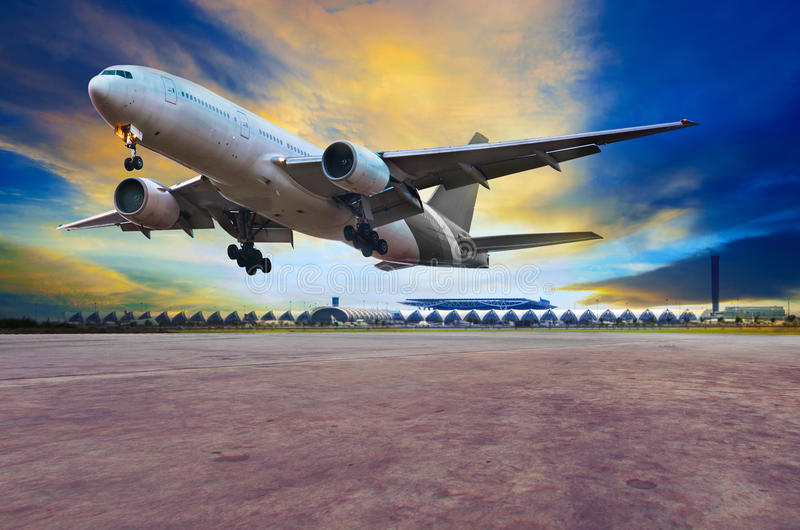 passenger jet plane landing on air port runways against beautiful dusky sky use for travel business and air transport royalty free stock images