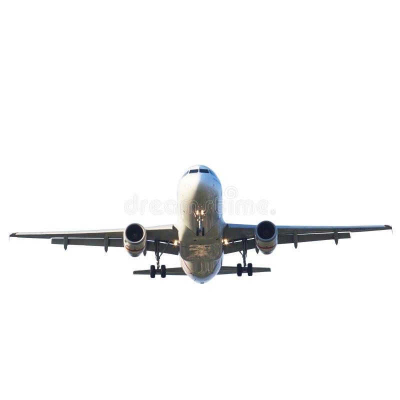 Passenger jet plane preparing to landing against beautiful dusky royalty free stock photo