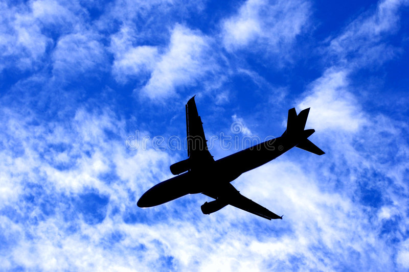 Download Passenger Jet Plane Silhouette On Cloudy Blue Sky Stock Photo - Image: 3751776