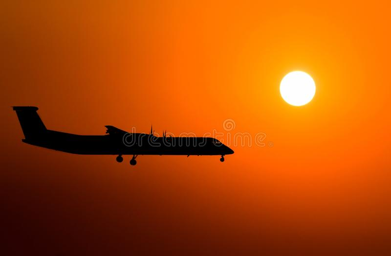 Passenger jet plane in the sky. Airplane flies high above the clouds stock photos