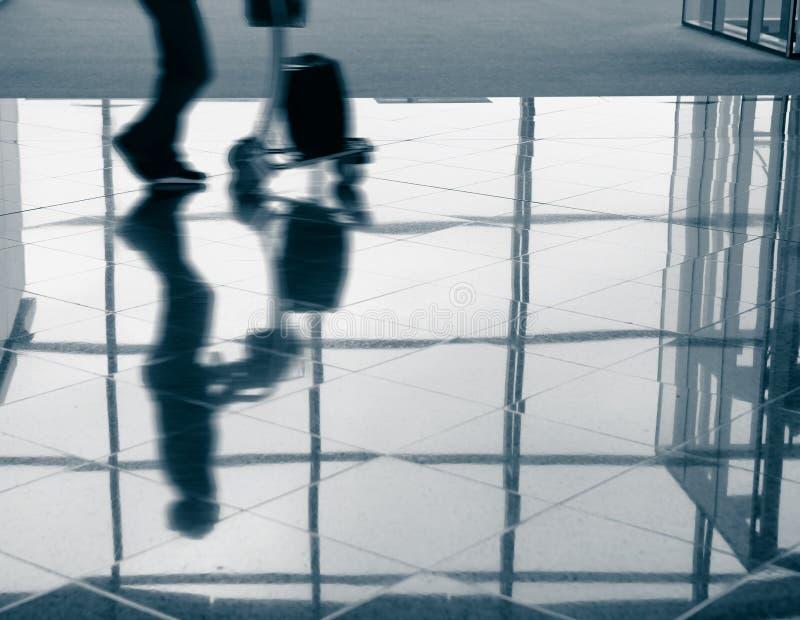 Download Passenger (Man) Rushing Through Airport Terminal Royalty Free Stock Photo - Image: 22810935