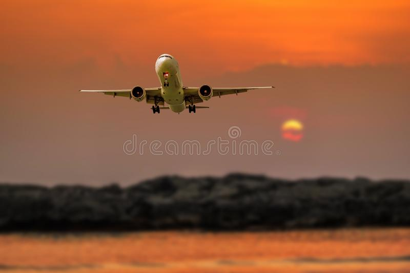 Passenger plane in flight. Aircraft fly high in the sky above the clouds. Front view of airplane royalty free stock photography