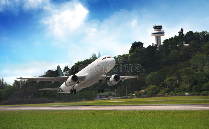 Passenger plane fly up over take-off runway royalty free stock images