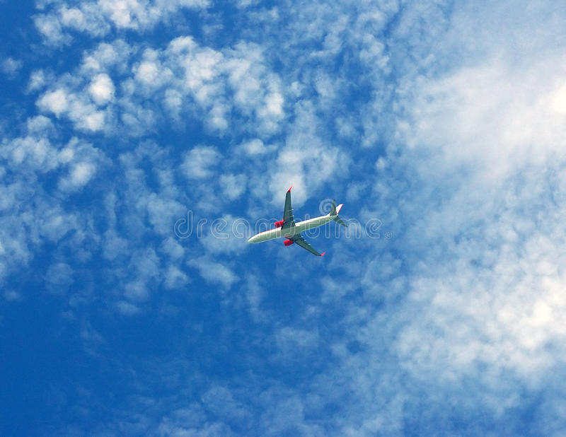 Passenger plane flying in sky background. Passenger plane flying high with blue sky background royalty free stock image