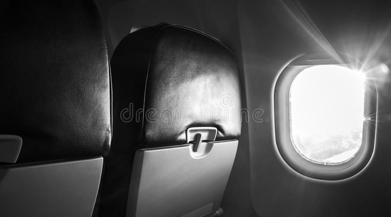 Passenger plane interior fragment, monochrome stock images