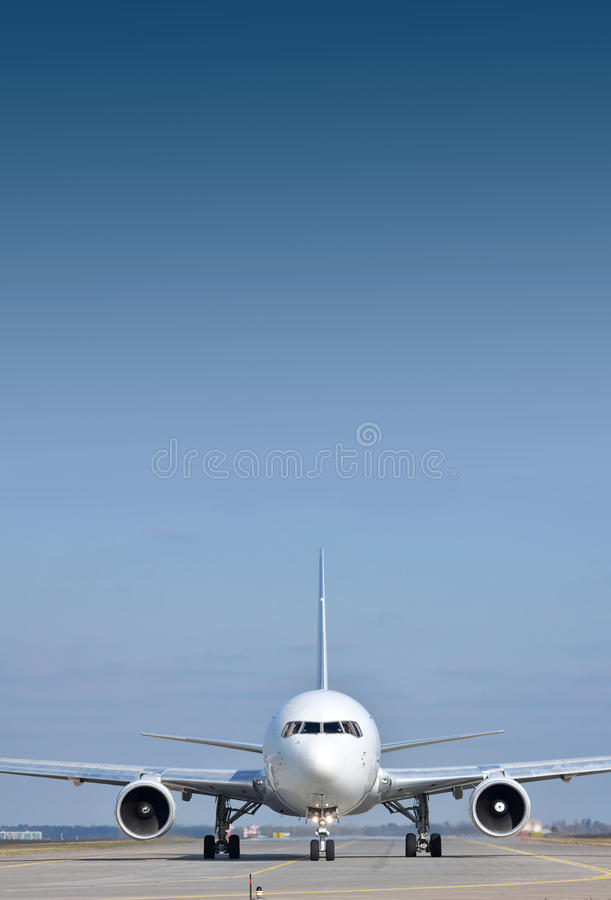 Passenger plane on runway royalty free stock photography