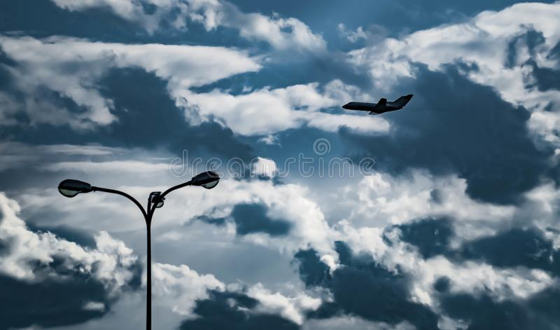 passenger plane silhouette in the airplane, blue, business, element, jet, plane, silhouette, sky, symbol, travel, aeroplane, air, royalty free stock photography