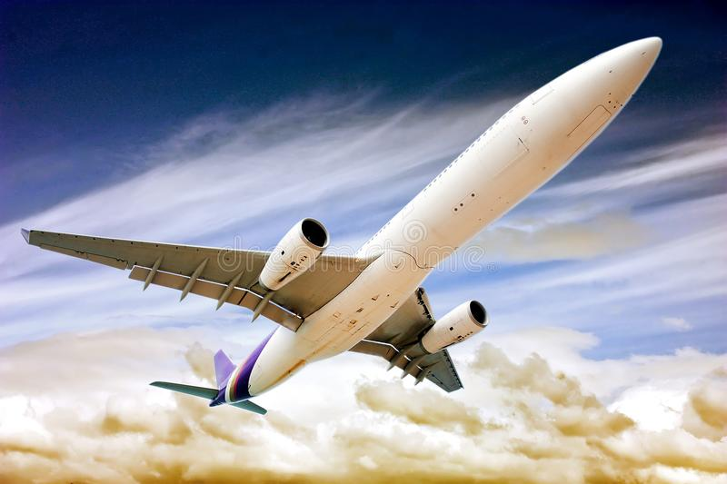 Passenger plane in the sky among the clouds. The concept of holidays and travel. Air transport travel stock images