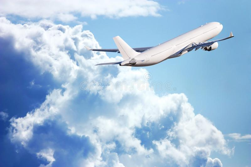 Passenger plane in the sky among the clouds. The concept of holidays and travel. Air transport travel stock image