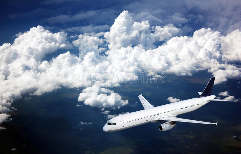 Passenger plane in the sky among the clouds. The concept of holidays and travel. Air transport travel royalty free stock image