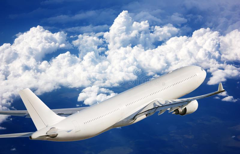Passenger plane in the sky among the clouds. The concept of holidays and travel. Air transport travel stock photos