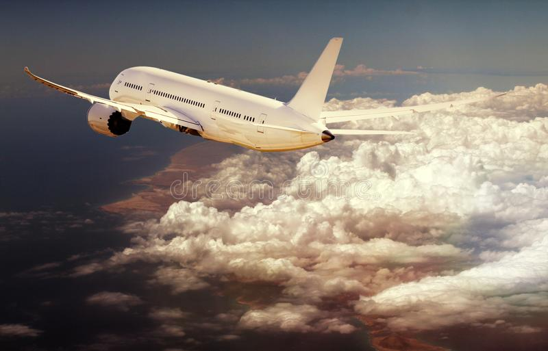 Passenger plane in the sky among the clouds. The concept of holidays and travel. Film effect. Passenger plane in the sky among the clouds. The concept of stock image