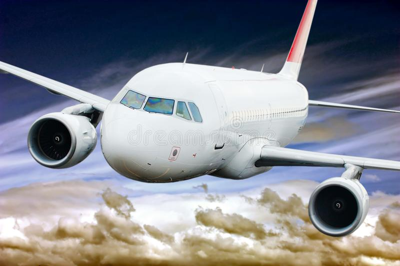 Passenger plane in the sky among the clouds. The concept of holidays and travel. Air transport travel stock photo