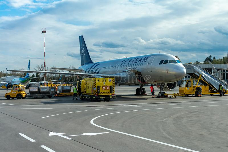 A passenger plane is standing at the airport in a parking space awaiting departure, the process of preparing for the flight is in. Russia, Moscow, Sheremetyevo stock photo