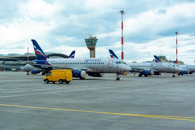 A passenger plane is standing at the airport in a parking space awaiting departure, the process of preparing for the flight is in. Russia, Moscow, Sheremetyevo stock images