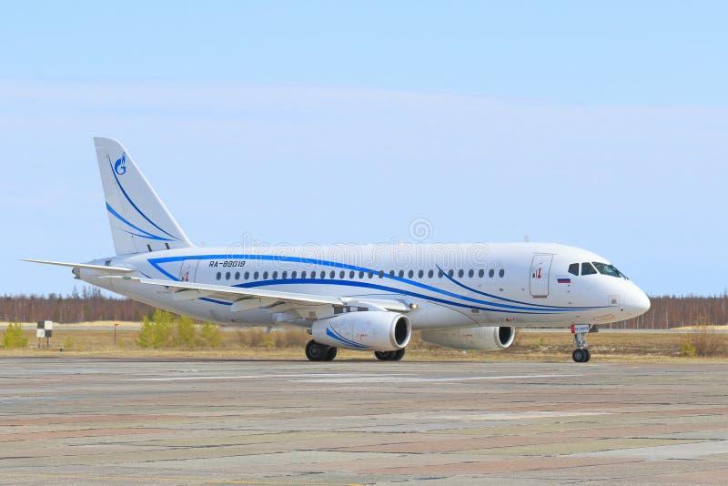 The passenger plane before take-off on Yamal. NADYM, RUSSIA - MAY 22, 2016: The SuperJet-100 RRJ-95LR-100 plane prepares for take-off. Plane of Gazpromavia stock photo