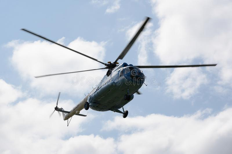Passenger russian helicopter MI-8 fly in sky royalty free stock images