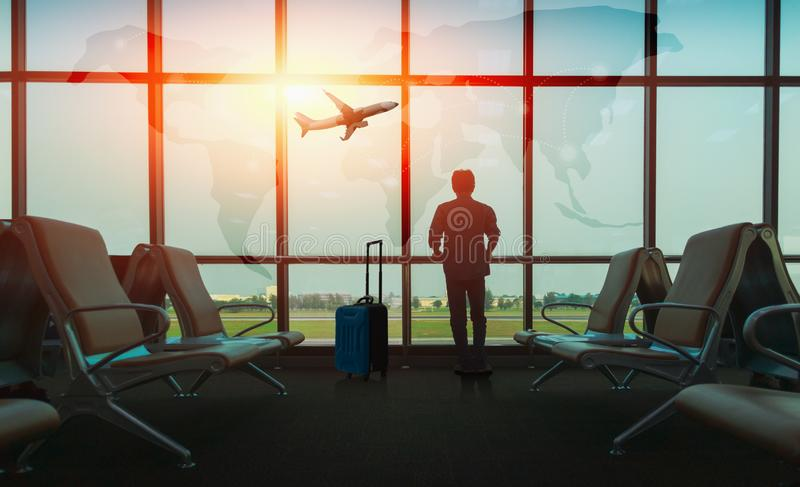 Passenger seat in departure lounge for see airplane, View from airport terminal. Sun light in vintage color selective focus, Trans royalty free stock photo