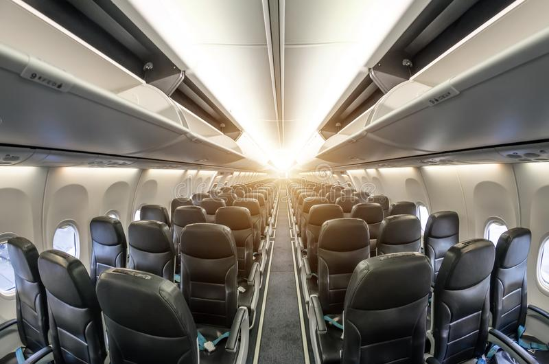 Passenger seat, Interior of airplane with passengers sitting on seats. stock images