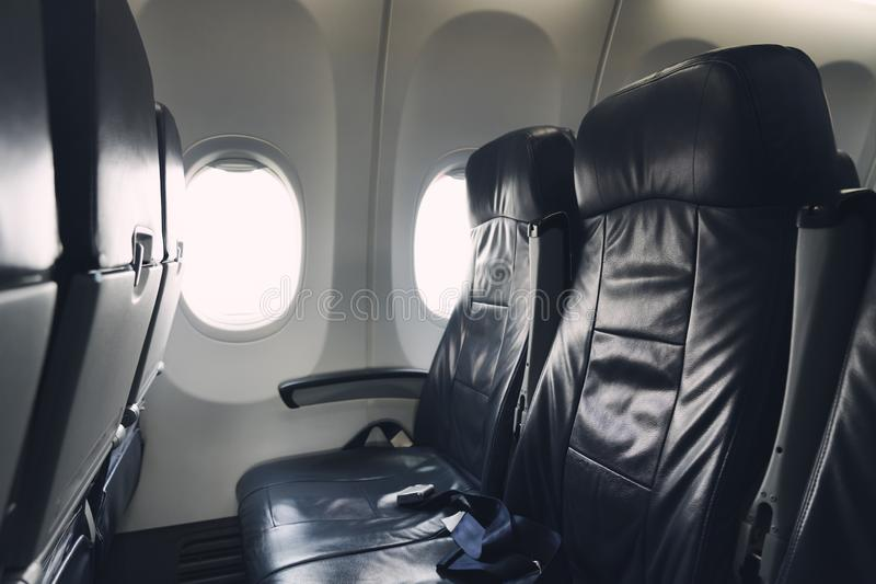 Passenger seat Of the plane The window seat position has a safety belt in every chair for safety. Safety concept Travel. Passenger seat Of the plane The window royalty free stock photography