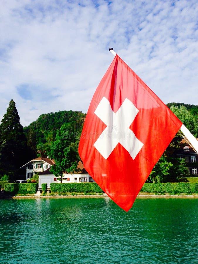 Passenger ship and swiss flag in Thun lake. Interlaken, Switzerland royalty free stock photo