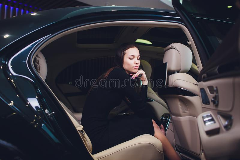 Passenger Successful Businesswoman Positive Talking Camera Inside Private Car. royalty free stock photos