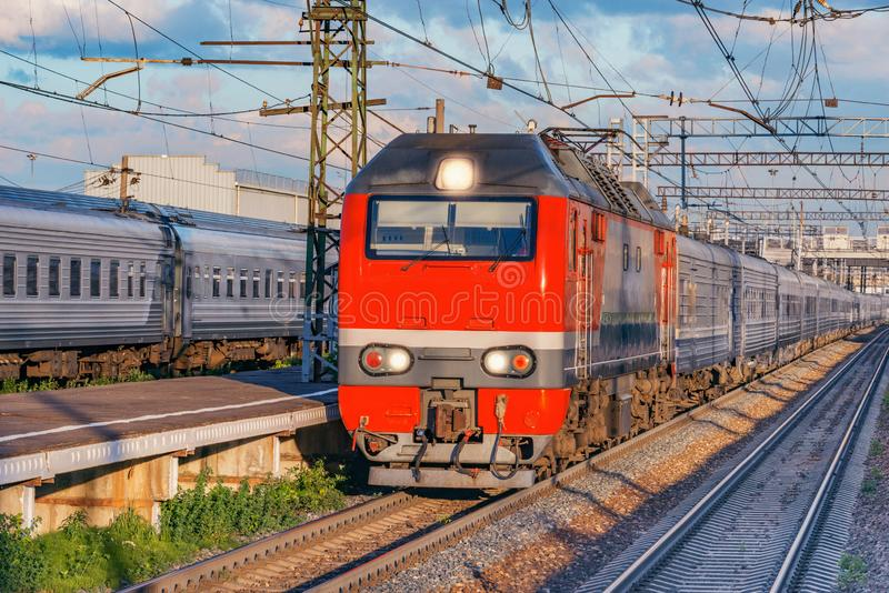 Passenger train approaches to the station platform. stock photos