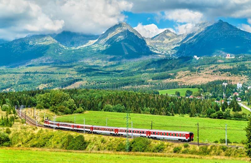 Passenger train in the High Tatra Mountains, Slovakia stock image