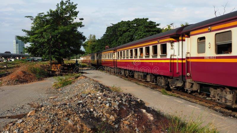 A passenger train leaves Bang Sue station. BANGKOK, THAILAND - AUGUST 12, 2018: A passenger train leaves Bang Sue station on August 12, 2018 in Bangkok, Thailand royalty free stock photo