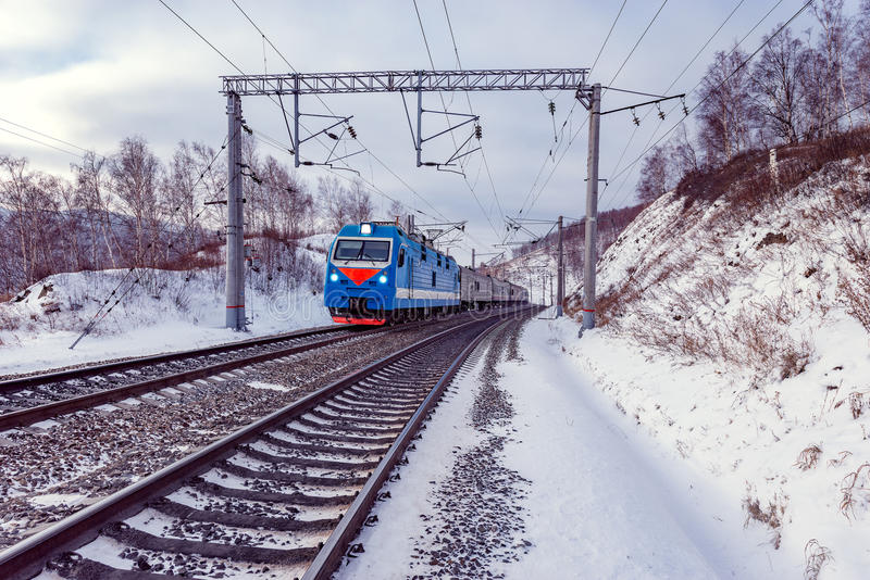 Passenger train moves along Baikal lake. Trans Siberian railway. Russia stock photos