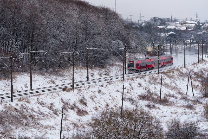 Passenger train running railway line Kaunas to Vilnius, Lithuania, aerial view royalty free stock photo