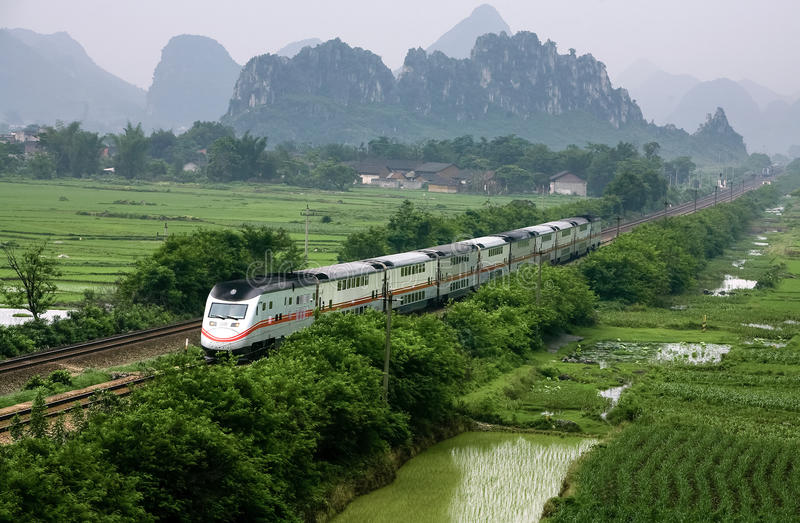 Passenger train,southwest mountain area,China. A passenger train or motor train unit in southwest mountain area,Guangxi province,China royalty free stock images
