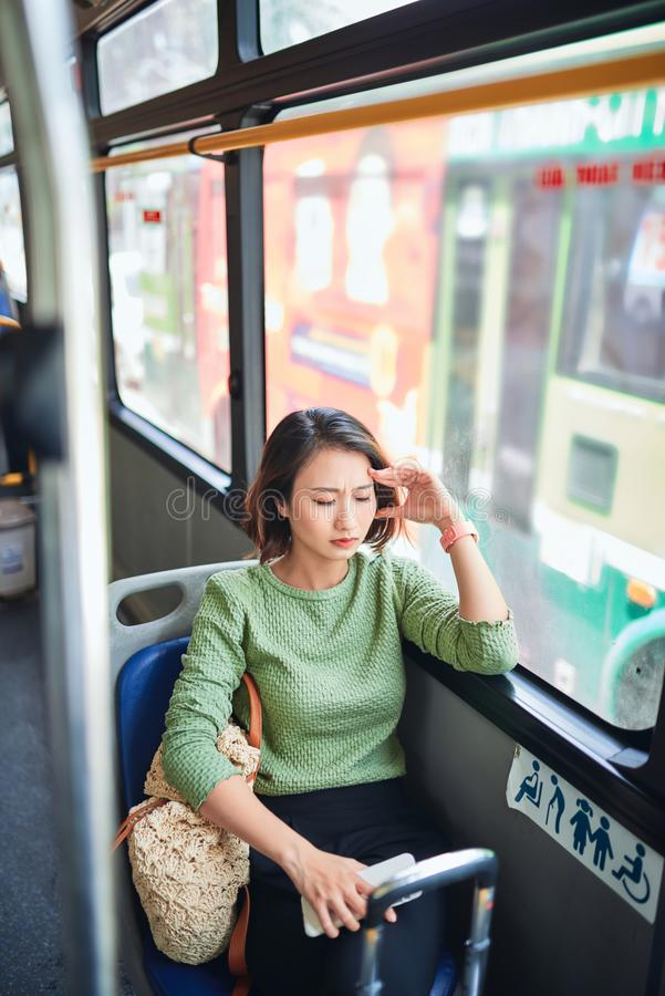 Passenger traveling and feeling dizzy with headache in a bus travel royalty free stock images