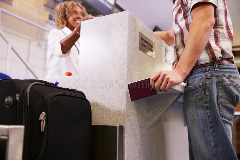 Passenger Weighing Luggage At Airport Check In royalty free stock images