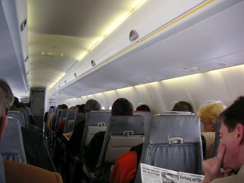 Passengers in Airplane cabin stock photo