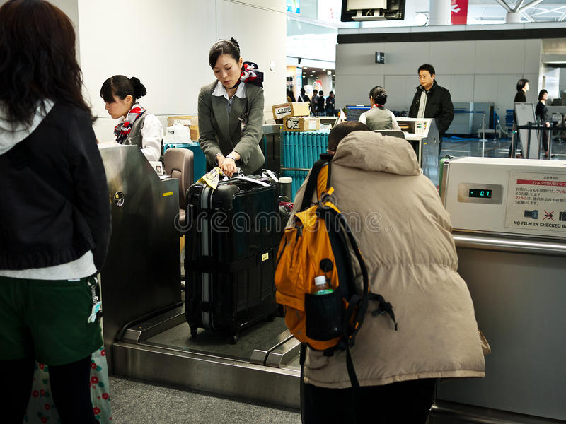 Passengers in airport. Passengers in the process of Denden machine procedures and checked baggage,in Central Japan International Airport Centrair, Nagoya city royalty free stock photos