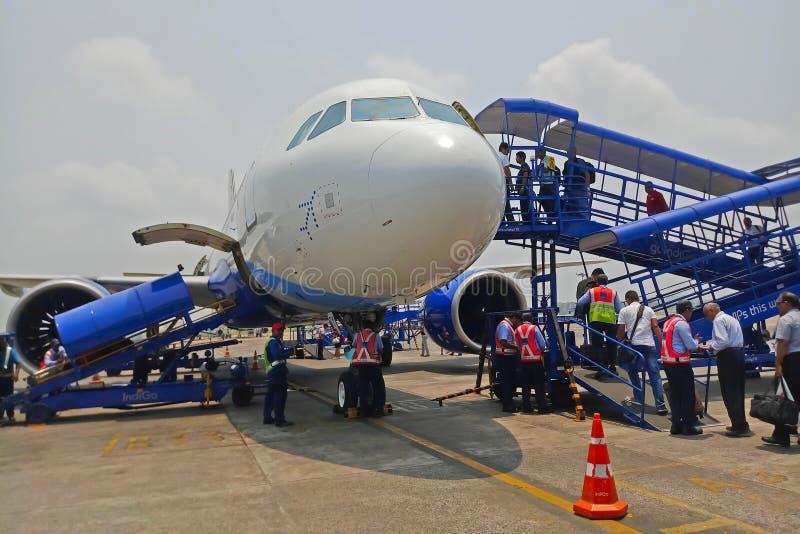 Passengers boarding a plane stock image