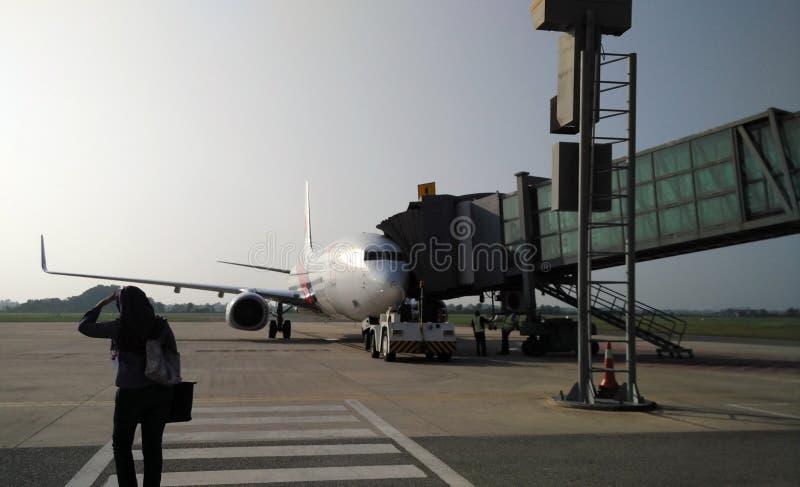 Passengers boarding a Plane stock photos