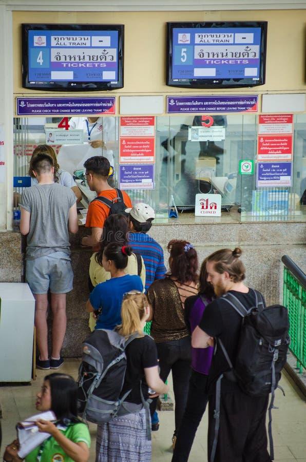 Passengers buy train tickets at Bangkok Thailand train station. stock photos
