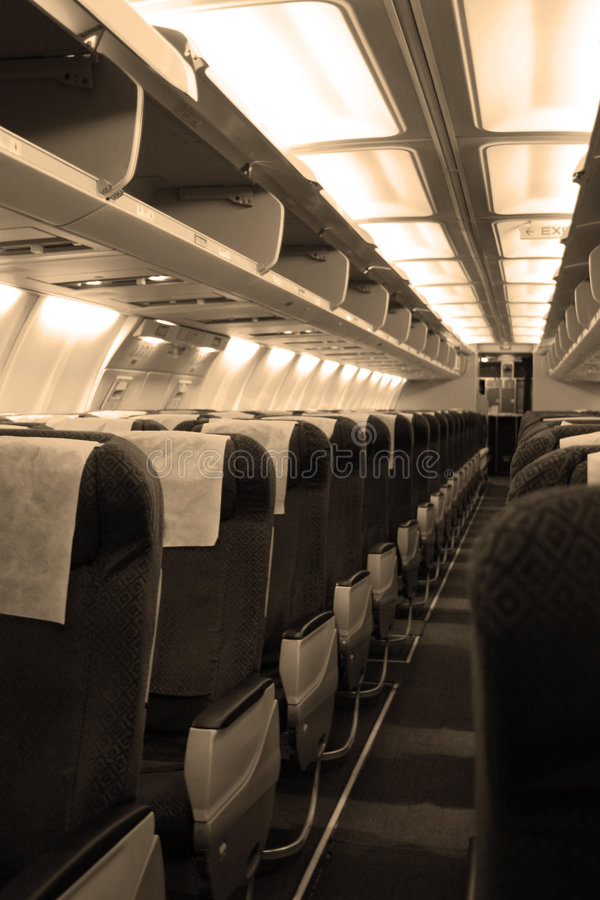 Passengers cabin in aircraft stock images