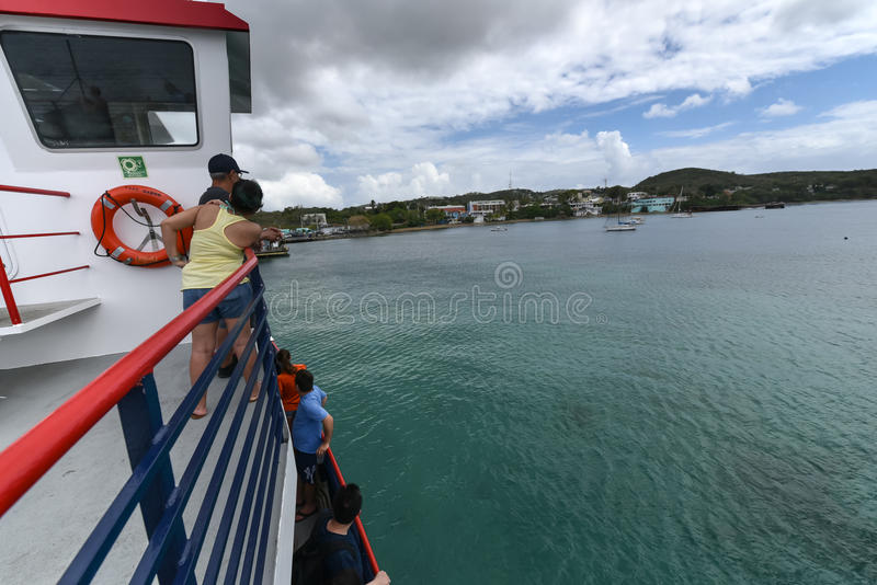 Passengers on Ferry from Fajardo to Vieques, Puerto Rico. VIEQUES, PUERTO RICO - MARCH 23: Locals and tourists crowd a ferry from Fajardo to the island of stock image