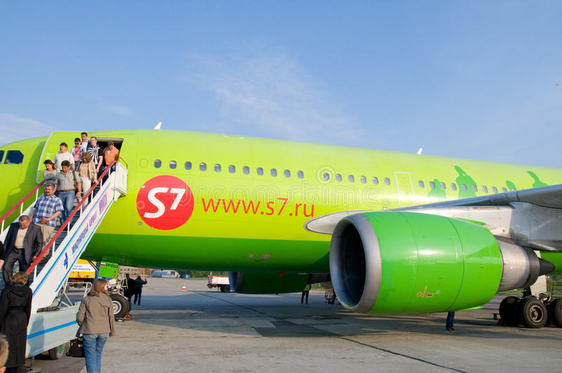 Passengers get off the plane stock photo