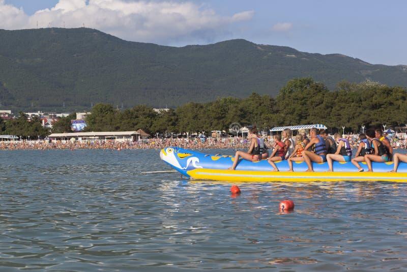Passengers inflatable banana ready for the water rides. Beach activities the resort city of Gelendzhik. Gelendzhik, Krasnodar region, Russia - July 16, 2015 royalty free stock photo
