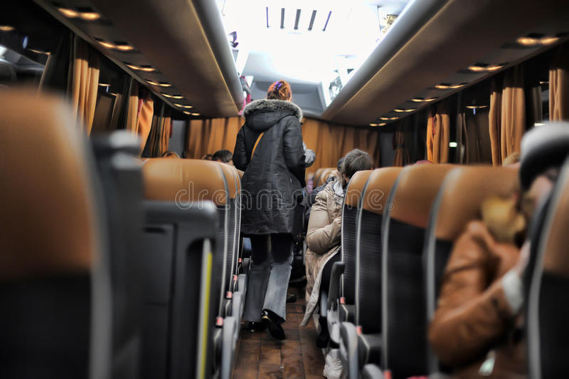 Passengers in the international tourist bus stock images