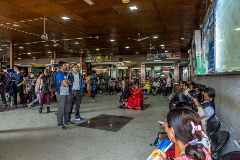 Passengers in Kathmandu international airport waiting for the fl stock photo