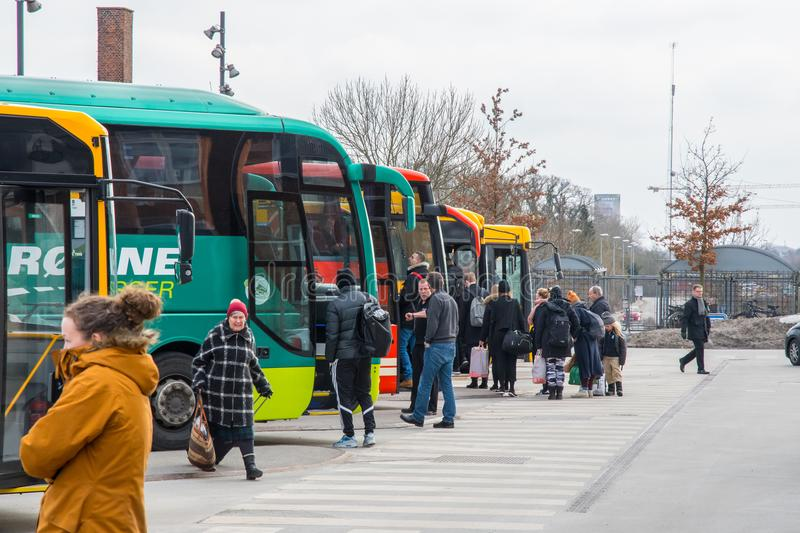 Passengers in line to enter the bus in front of Vordingborg train station royalty free stock photography