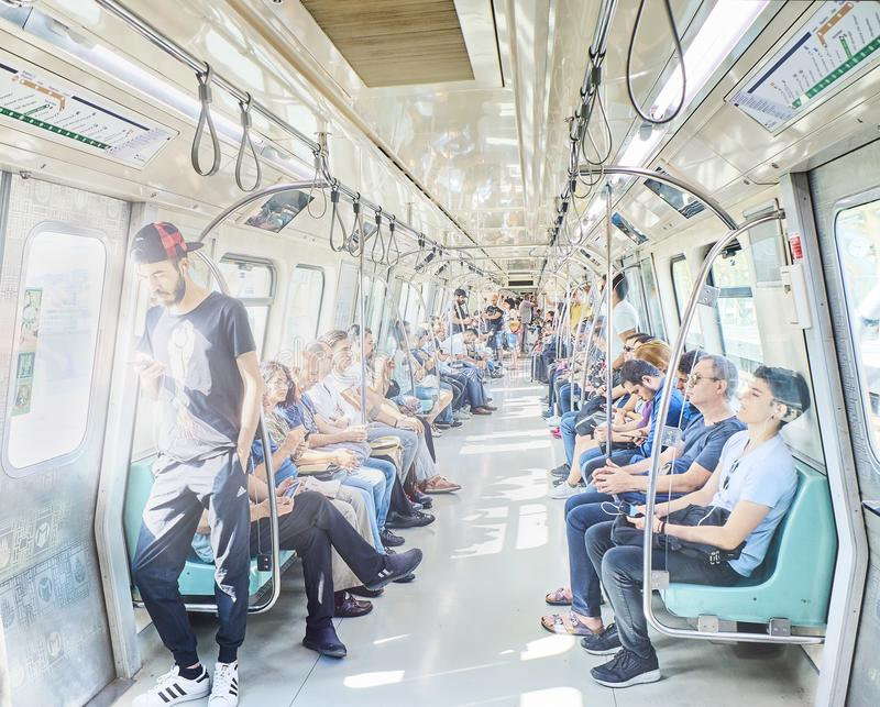 Passengers in modern subway wagon of Istanbul Metrosu. royalty free stock photos