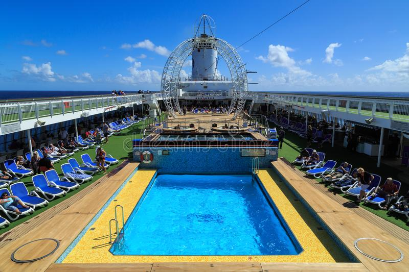 The pool deck of a cruise liner on a sunny day royalty free stock photo