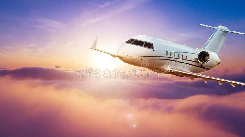 Passengers private airplane flying above clouds royalty free stock photography
