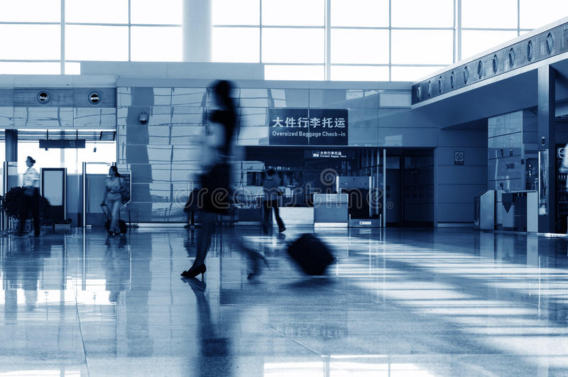 Passengers at the Shanghai pudong airport. Passenger in the shanghai pudong airport.interior of the airport royalty free stock photography